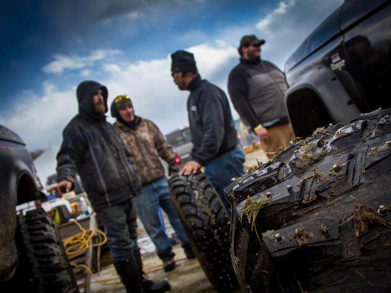 Participants in the Vermonster winter competition prepare their trucks for racing