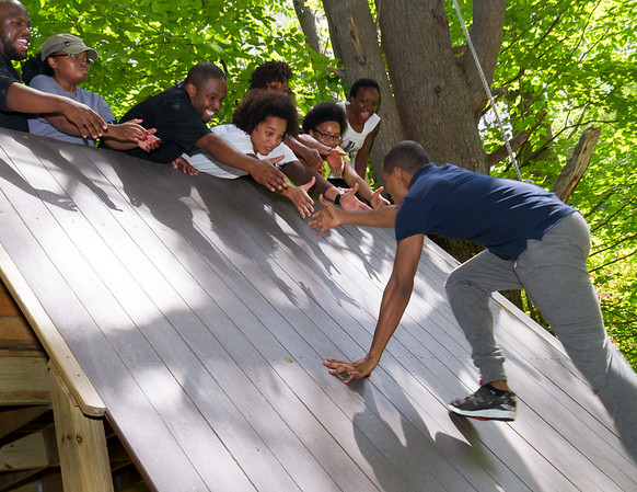 Washington Fellows taking part in the Young African Leadership Initiative at Dartmouth College collaborate to complete the Outing Club ropes course at Oak Hill in Hanover, NH