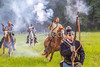 Confederate cavalry chase Union soldiers at Centralia, MO, 150th anniversary reenactment - C1-0357 - 72 ppi
