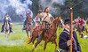 Confederate cavalry chase Union soldiers at Centralia, MO, 150th anniversary reenactment - C1-0358 - 72 ppi