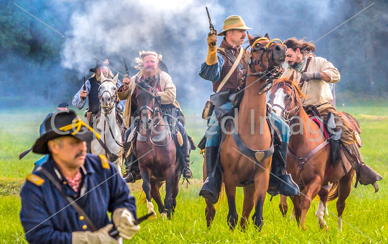Confederate cavalry chase Union soldiers at Centralia, MO, 150th anniversary reenactment - C1-0351 - 72 ppi