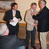 President Gareth inducting Steve into Rotary ably assisted by Ken