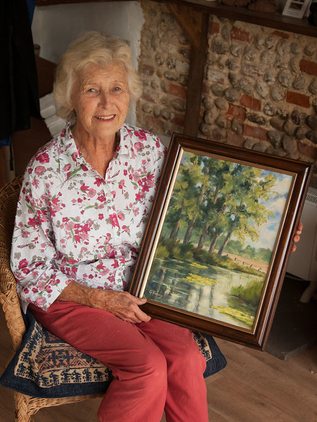 Gill Savory with her donated picture 2013