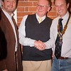 Andrew Hadley being inducted into the club by President Gareth Homfray-Davies and Ian Malton