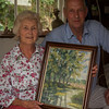 Peter Day accepting an oil painting from Artist Gill Savory as one of the prizes for the Aylsham Show Art Tent Raffle