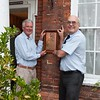 President Robert with founder member Paul Smith showing where the plaque has been for many years.