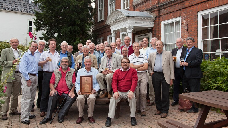 Members outside the Old Brewery House Hotel before their last meeting there. President Robert Buxton has the refurbished sign ready for use at the new venue which will be announced very shortly