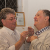 Richard Cooke trying to pin a Rotary badge on to John Pickering