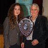 Evie Moss with the Youth Speaks Trophy presented by Trevor Nelson of the Rotary Club