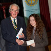 Evie Moss collecting her winning cheque from President Andrew