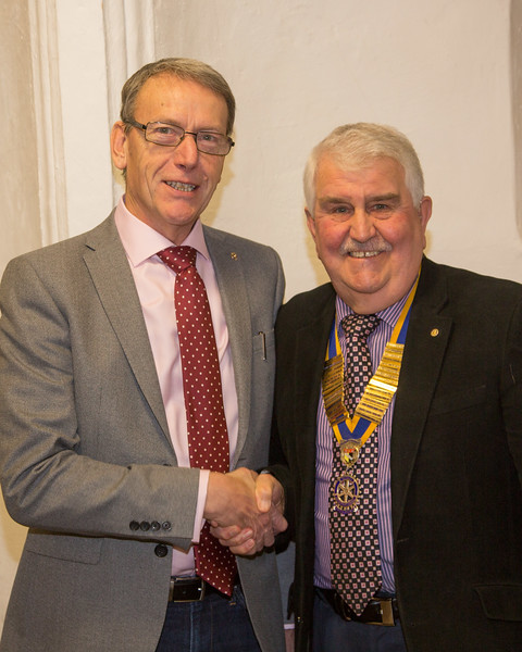President Trevor welcoming new member Richard Fisher into the club
