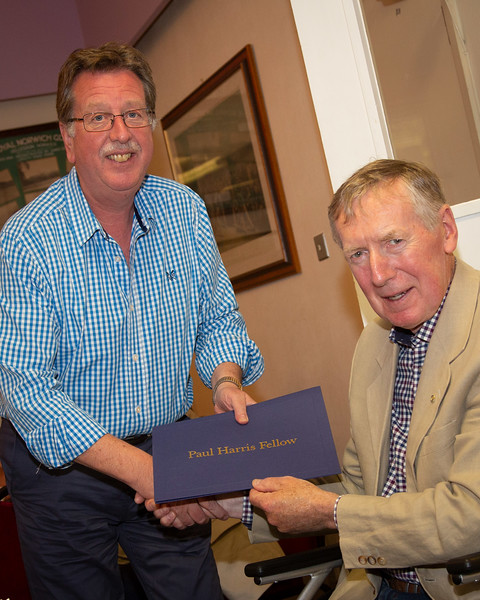 David Baxter recieving a Paul Harris Award from President Steve Griggs