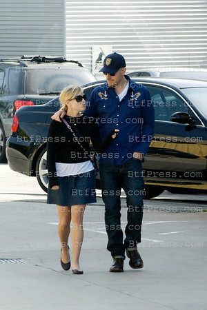 Reese Wtherspoon and fiance Jim Toth leaving church in Los Angeles,California on March 13,2011.