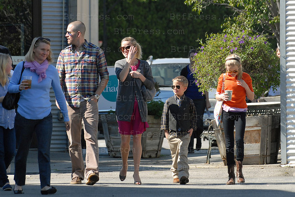 Reese Witherspoon with boyfriend Jim Toth and her kids Ava and Deacon come back from the church in front of a wall of paparazzi. In Los Angeles,California.