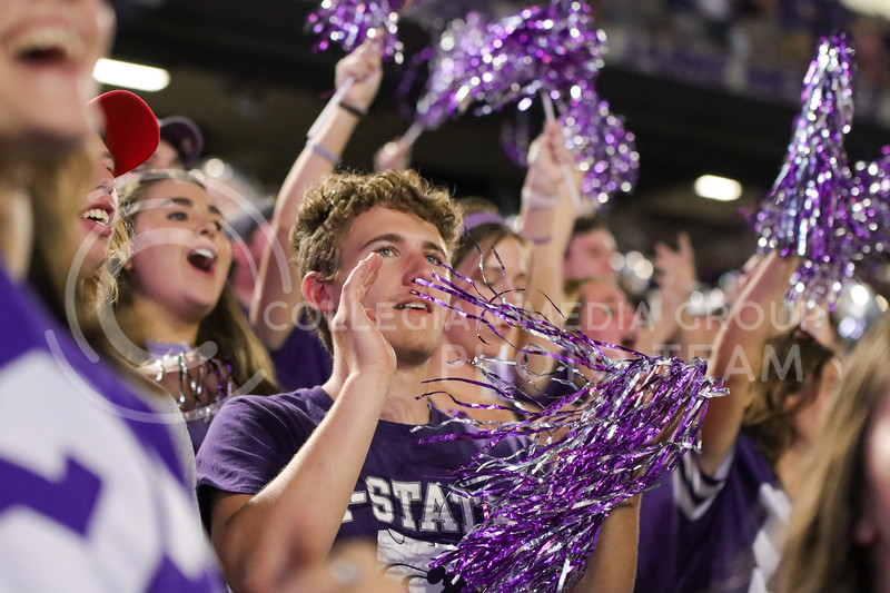 Awestruck, students celebrate a great play by the wildcats with waving pom-poms and loud cheers (Kendall Spencer | Collegian Media Group).