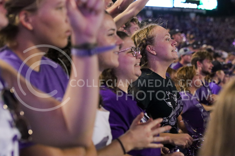 Teeth Gritted, students anxiously await the results of a flag thrown on a fourth-quarter play (Kendall Spencer | Collegian Media Group).