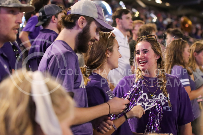 Making memories, students enjoy the first game back at the Bill by laughing with friends (Kendall Spencer | Collegian Media Group).