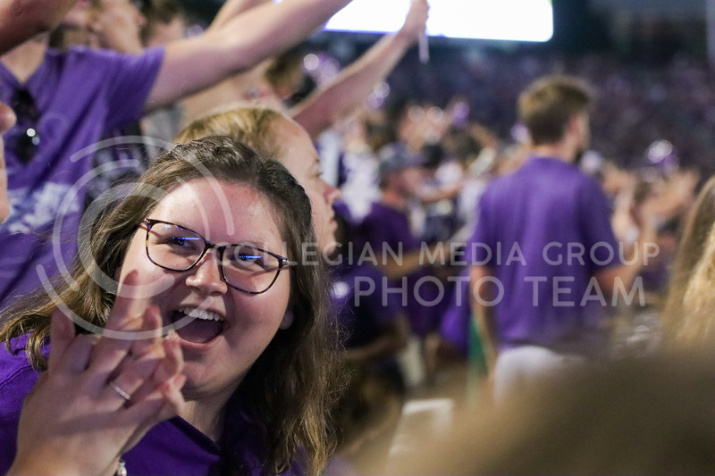 Beaming with excitement, students celebrate another wildcat touchdown against Southern Illinois (Kendall Spencer | Collegian Media Group).