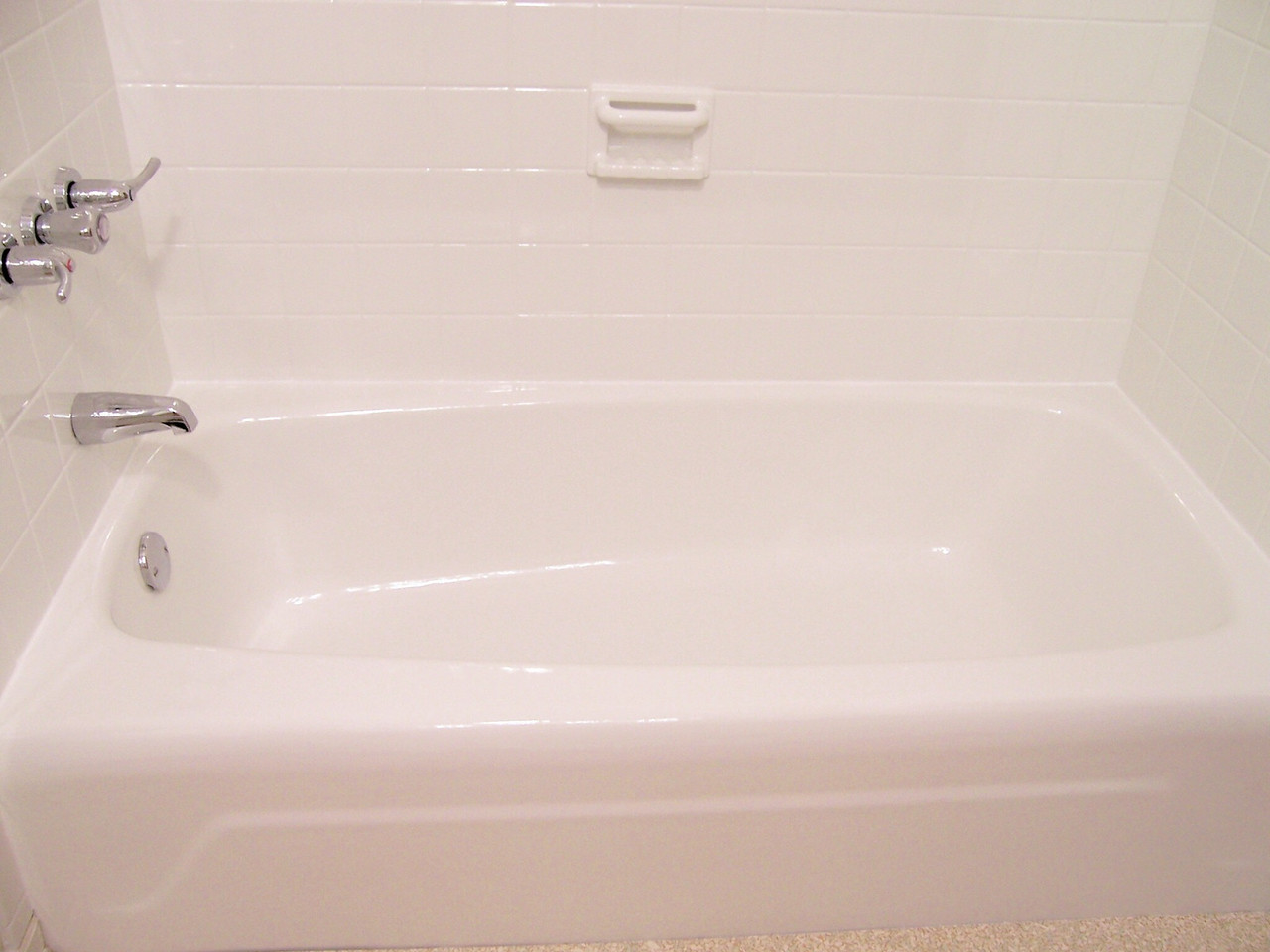 AFTER-The great thing about refinishing tile is that it seals the grout. No more ugly grout or re-grouting.