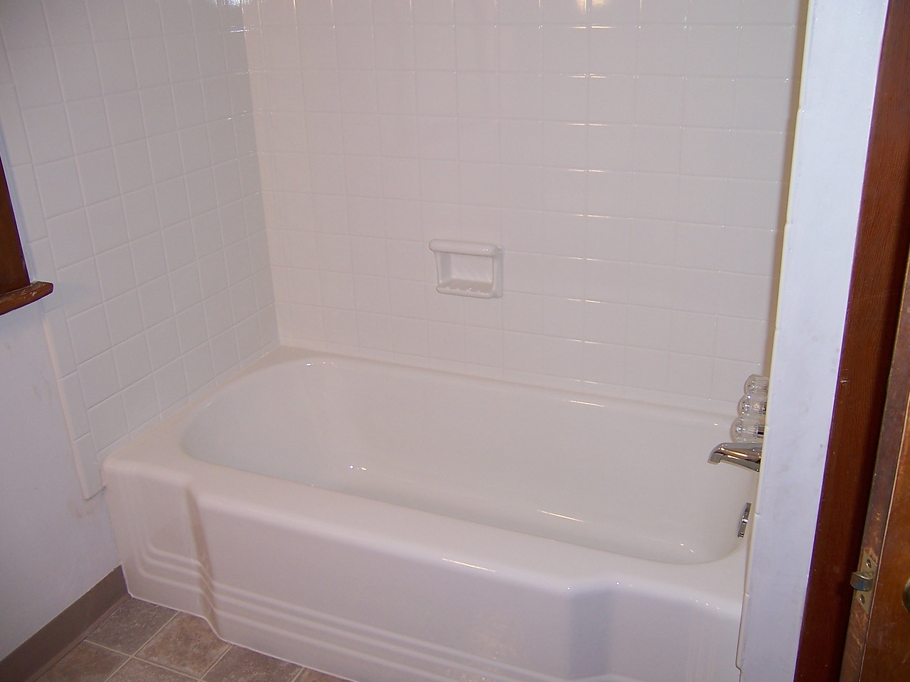 AFTER-   You can't see it but the tile goes to a ceiling above the tub. I couldn't get back far enough for a full view of the improvements.