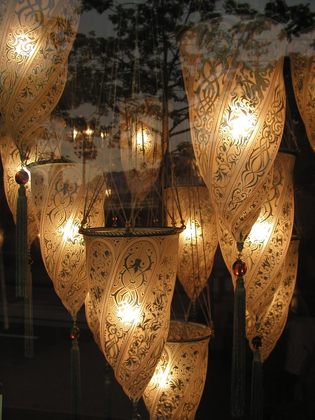 Maroccan chandelier with tree window reflections