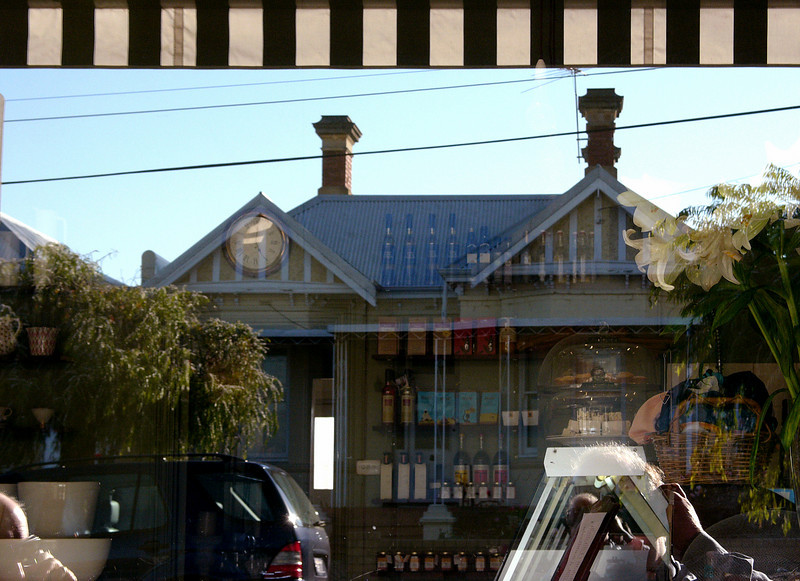 Deli window, North Perth, 2005.<br /> Ron at left on mobile phone, me and Digilux 2 on right.