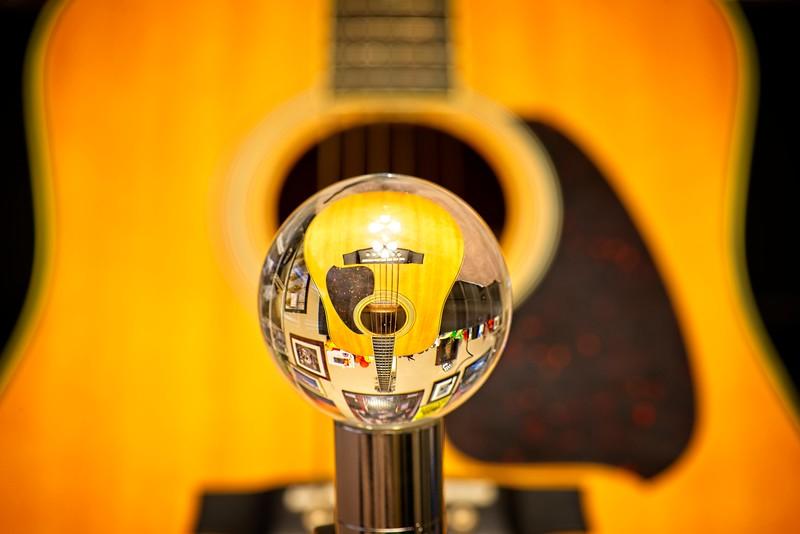 My son's Ibanez guitar as seen through a lensball
