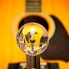 My son's Ibanez guitar as seen through a lensball