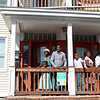 Refugees from the Democratic Republic of Congo who recently settled in Lowell after living in a refugee camp for decades in stand on the porch of their home in. From left is Vanisi Uzamukunda, 43, with her husband Sendegeya Bayavuge, 52, and their kids Sarah Nyiramana Bayavuge, 6, Dusenge Tuyishime, 14, Maria Uwimana, 16, Nyirakabanza Muhawenimana, 20, and Lea Nyiramahoro, 11. SUN/JOHN LOVE