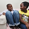 Refugees from the Democratic Republic of Congo who recently settled in Lowell after living in a refugee camp for decades in stand on the porch of their home in.Sitting on the couch in their new home is Dusenge Tuyishime, 14, and his sister Lea Nyiramahoro, 11. SUN/JOHN LOVE