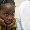Lea Nyiramahoro, 11, is a refugee from the Democratic Republic of Congo who recently settled in Lowell after living in a refugee camp for decades in Uganda with their family. SUN/JOHN LOVE