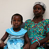 Vanisi Uzamukunda, 43, sits with her daughter Sarah Nyiramana Bayavuge, 6, and her family at their home on Monday February 27, 2017. they are refugees from the Democratic Republic of Congo who recently settled in Lowell after living in a refugee camp for decades in Uganda. SUN/JOHN LOVE