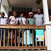 Refugees from the Democratic Republic of Congo who recently settled in Lowell after living in a refugee camp for decades in stand on the porch of their home in. From left is Dusenge Tuyishime, 14, Maria Uwimana, 16, Nyirakabanza Muhawenimana, 20, Sarah Nyiramana Bayavuge, 6, Vanisi Uzamukunda, 43, Sendegeya Bayavuge, 52, and Lea Nyiramahoro. SUN/JOHN LOVE