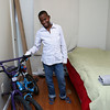 Dusenge Tuyishime, 14, in his new bedroom, is a refugee from the Democratic Republic of Congo who recently settled in Lowell after living in a refugee camp for decades in Uganda with their family. SUN/JOHN LOVE