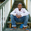 Dusenge Tuyishime, 14, sitting on the steps of his back porch, is a refugee from the Democratic Republic of Congo who recently settled in Lowell after living in a refugee camp for decades in Uganda with their family. SUN/JOHN LOVE