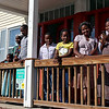 Refugees from the Democratic Republic of Congo who recently settled in Lowell after living in a refugee camp for decades in stand on the porch of their home in. From left is Vanisi Uzamukunda, 43, with her husband Sendegeya Bayavuge, 52, and their kids Sarah Nyiramana Bayavuge, 6, Dusenge Tuyishime, 14, Lea Nyiramahoro, 11, Maria Uwimana, 16, and Nyirakabanza Muhawenimana, 20. SUN/JOHN LOVE