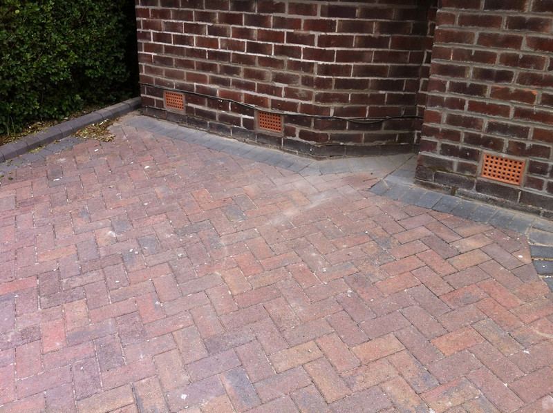 We put down a blue tarp to stop any mortar dropping onto the block paving.