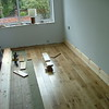 The floor is layed into the window to make the room look bigger. You can see the floor nailer and the felt underlay in this picture.