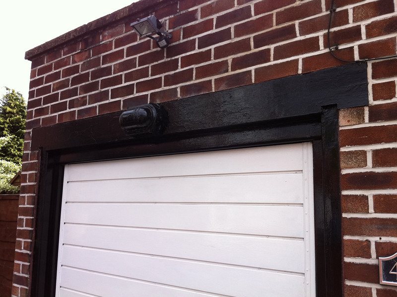 The garage door frame repaired and painted.