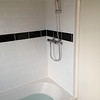 "New tiles and shower installed by  <a href=""http://www.urmstonhandyman.co.uk"">http://www.urmstonhandyman.co.uk</a>"