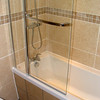 Tintern Avenue, Umrston : Complete bathroom renovation by www.urmstonhandyman.co.uk White Granite tile and Chrome fixtures. New window frame also installed.