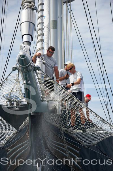 Crew washing bowsprit