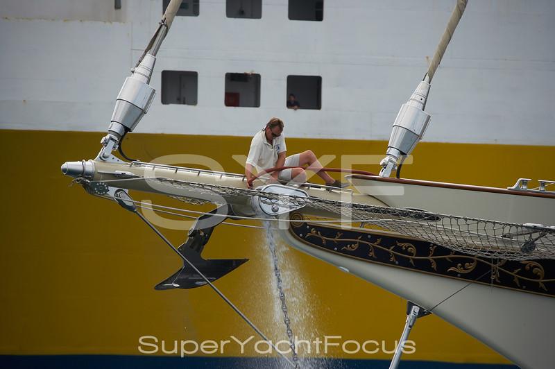 Crew washing anchor chain