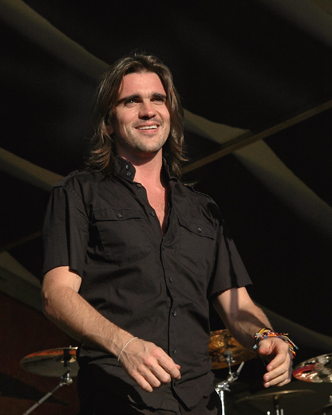 Juanes performs at the New Orleans Jazz & Heritage Festival on April 24, 2005.