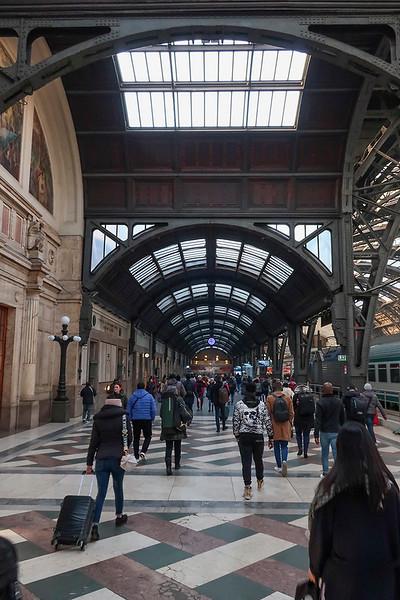 Boarding a train for Reggio Emelia at Milano Centrale.