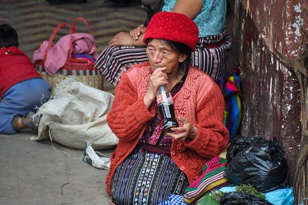 Drinking coca-cola, Chichicastenango, Guatemala