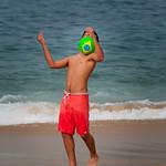 Brazilian kid juggling with football, Copacabana, Rio de Janeiro, Brazil.