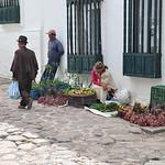 Tired woman selling goods in Villa de Leyva, Colombia