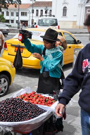Ecuadorian selling fruits, Cuenca, Ecuador