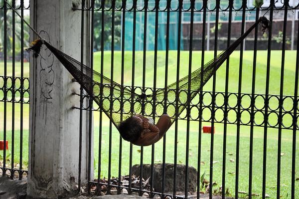 Baby sleeping in a hammock in Manila, Philippines